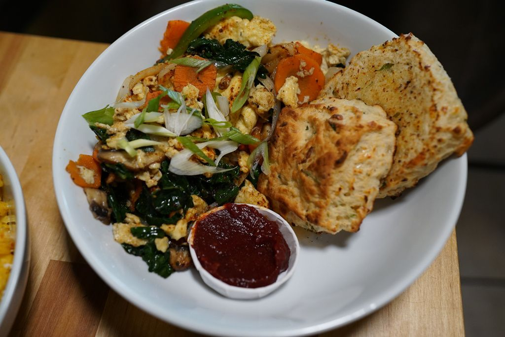 Veg out scramble, served at Smack Dab restaurant, is made with two cage free eggs, vegetables, butter and spices. Sub in tofu for a vegan option.