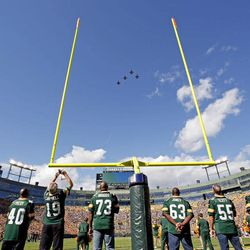 Planes fly over Lambeau Field after the national anthem before an NFL football game between the Green Bay Packers and the San Francisco 49ers Sunday, Sept. 9, 2012, in Green Bay, Wis.