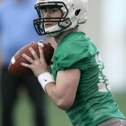 Tanner Magnum passes the ball during BYU spring football practice at BYU in Provo on Friday, March 22, 2013.
