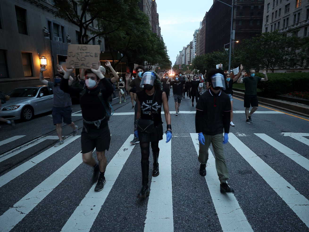 Protesters walk down a New York City street.