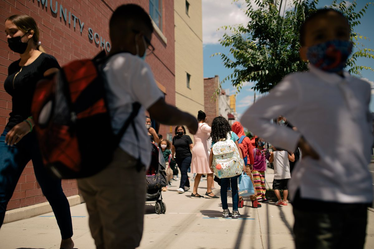 Students and parents walk by P.S. 89 on a beautiful June day.