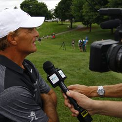 Doug Flutie is interviewed by the local media.