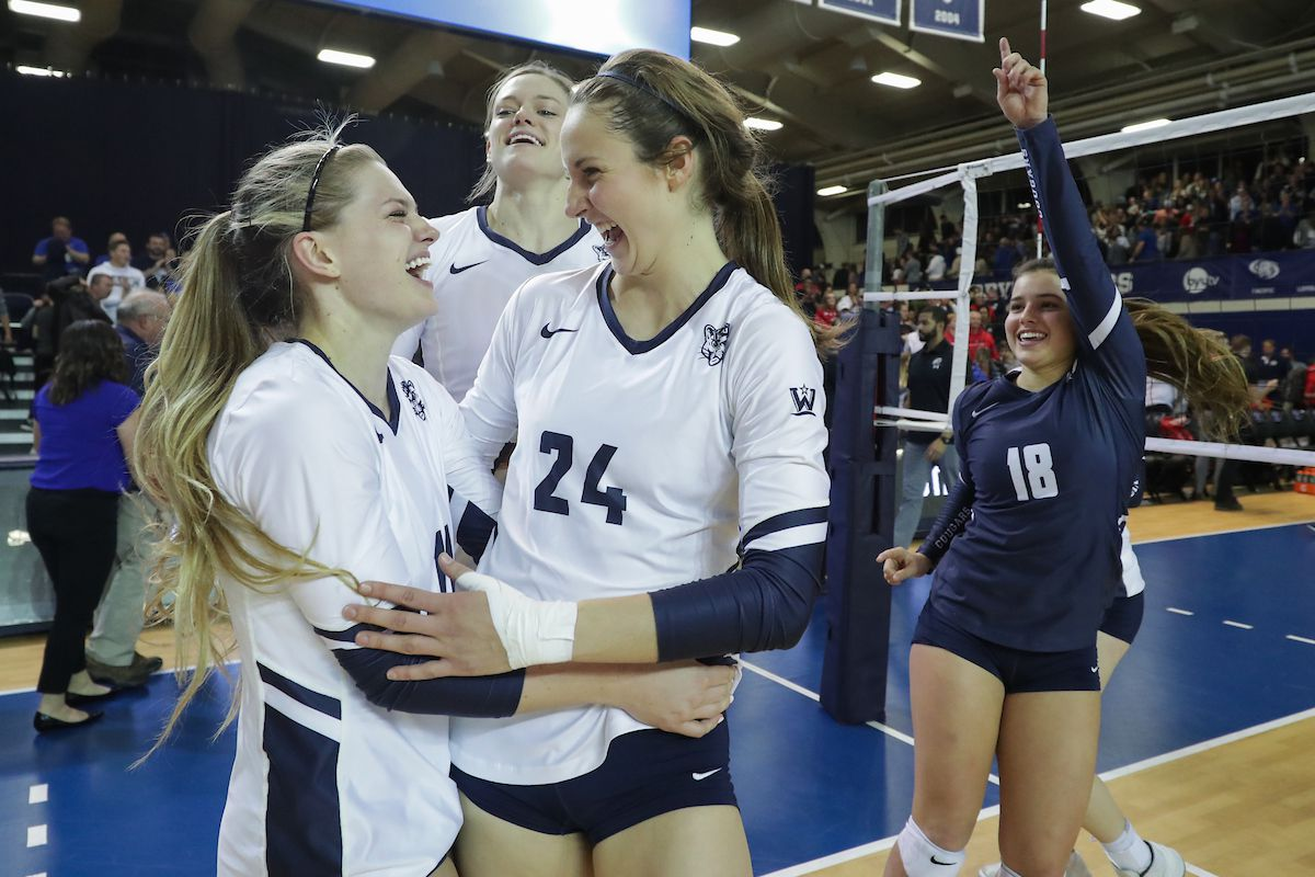 BYU's Lacy Haddock, Kennedy Eschenberg and Mary Lake celebrate after their win over Utah. The BYU Women's Volleyball team defeated Utah 3-0 in the 2nd Round of the NCAA Championships in the Smith Fieldhouse in Provo.