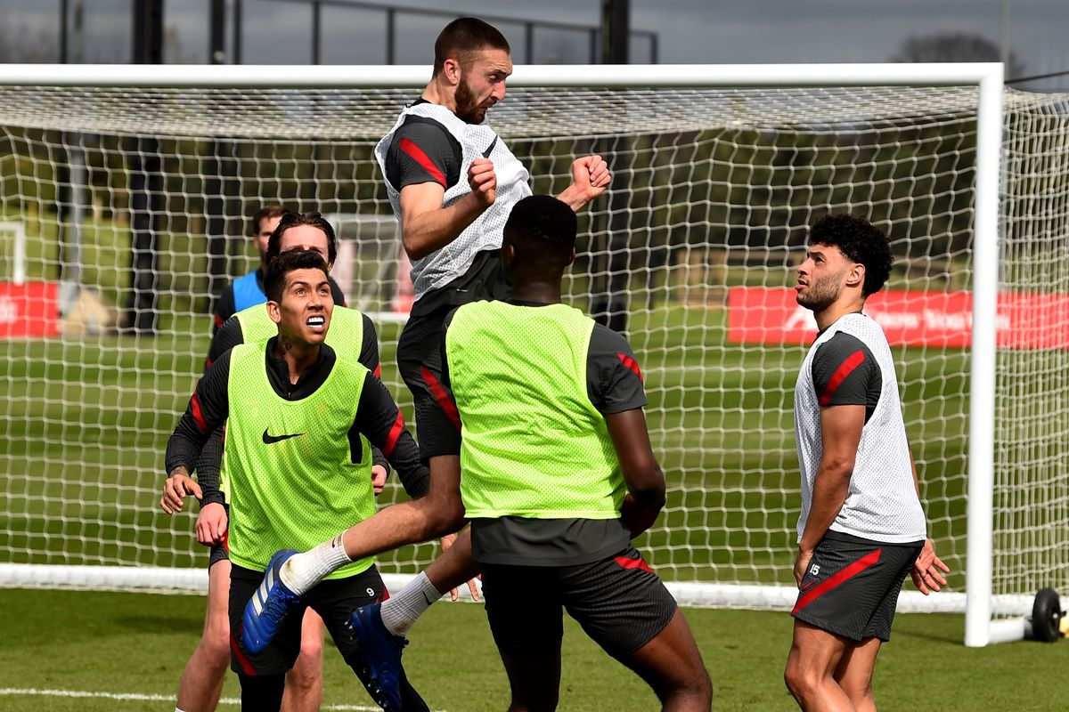 Nathaniel Phillips in his natural role during a training session, leaping for a header above the rest of the lads, impeccable beard intact.