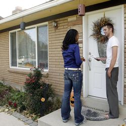 Candidate Mia Love talks with John Voshell as she walks door to door in West Valley City on Friday, Nov. 2, 2012.