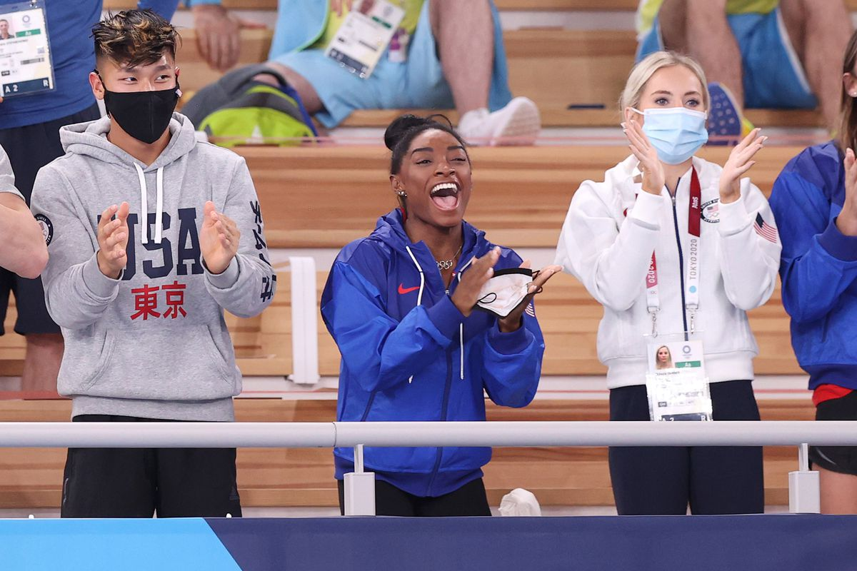 Yul Moldauer, Simone Biles and MyKayla Skinner applaud during the Women's Floor Exercise Final on day ten of the Tokyo 2020 Olympic Games at Ariake Gymnastics Centre on August 02, 2021 in Tokyo, Japan.