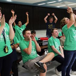 West Jordan Middle School students cheer their school as middle school students who have been involved in an after-school STEM program compete in West Jordan on Wednesday, May 27, 2015.