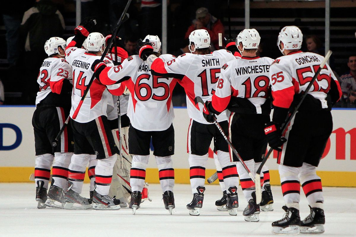 The Senators celebrate a shootout win over the New York Rangers after an incredible come back. New York still got a point though, despite blowing a 4-1 lead. (Photo by Chris Trotman/Getty Images)