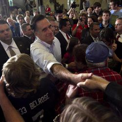 Republican presidential candidate, former Massachusetts Gov. Mitt Romney greets people in a crowd during a campaign event at a metal working shop, in Broomall, Penn., Wednesday, April 4, 2012.