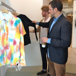 Reviewing colorful tops at a DTLA showroom