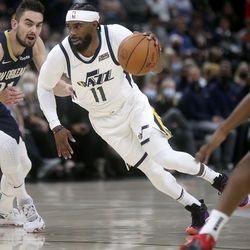 Utah Jazz guard Mike Conley (11) dribbles during a preseason NBA game against the New Orleans Pelicans at the Vivint Smart Home Arena in Salt Lake City on Monday, Oct. 11, 2021.