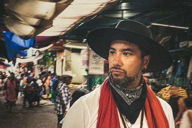 Joshua Gil in an a Mexican market