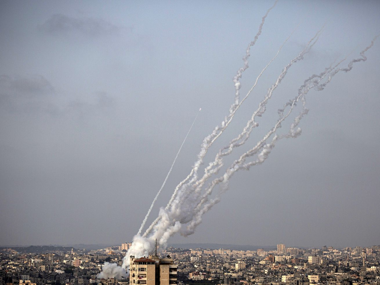 In this May 10, 2021 file photo, rockets are launched from the Gaza Strip towards Israel.