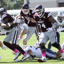 Mississippi State quarterback Nick Fitzgerald (7) leaps over a BYU defender to score a touchdown during the first half of an NCAA college football game in Starkville, Miss., Saturday, Oct. 14, 2017. (AP Photo/Jim Lytle)