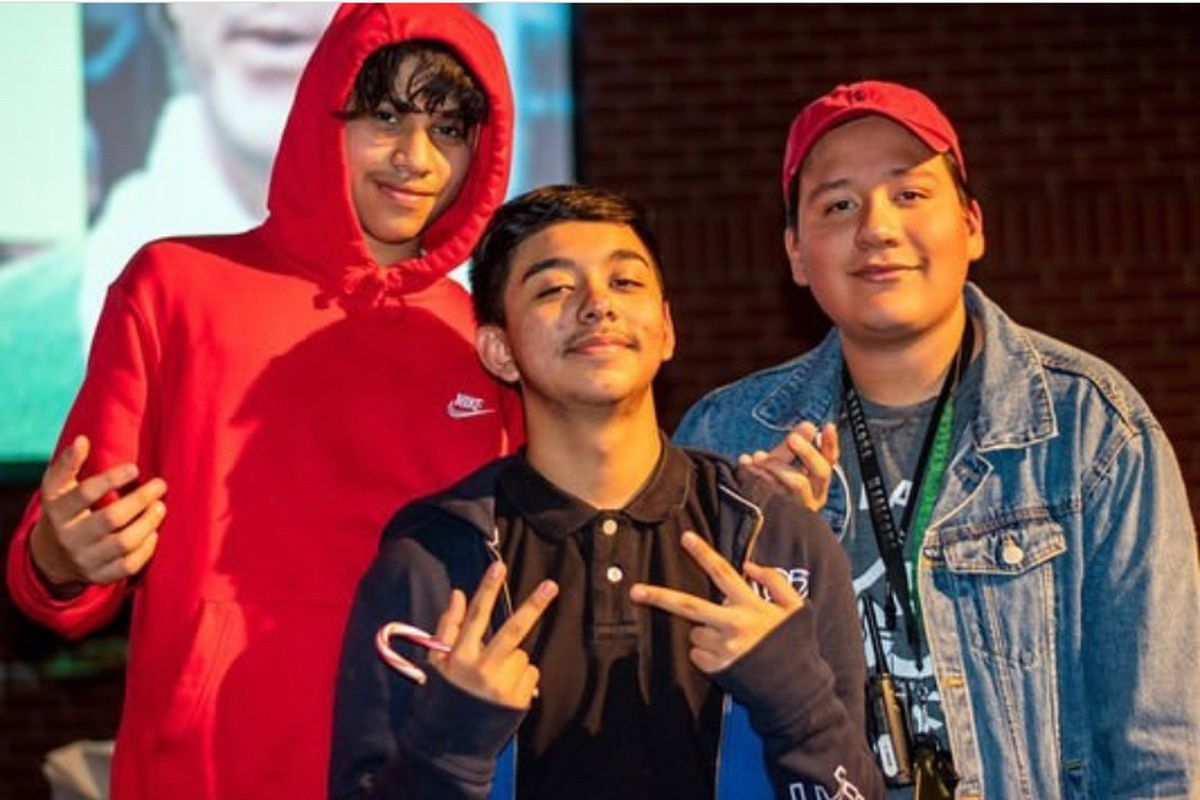 José Ayala (right) joins two of his mentees, José Rameiz (left) and Rene García, stand together at an end-of-the-year party at Streets Ministries in Memphis in 2020.