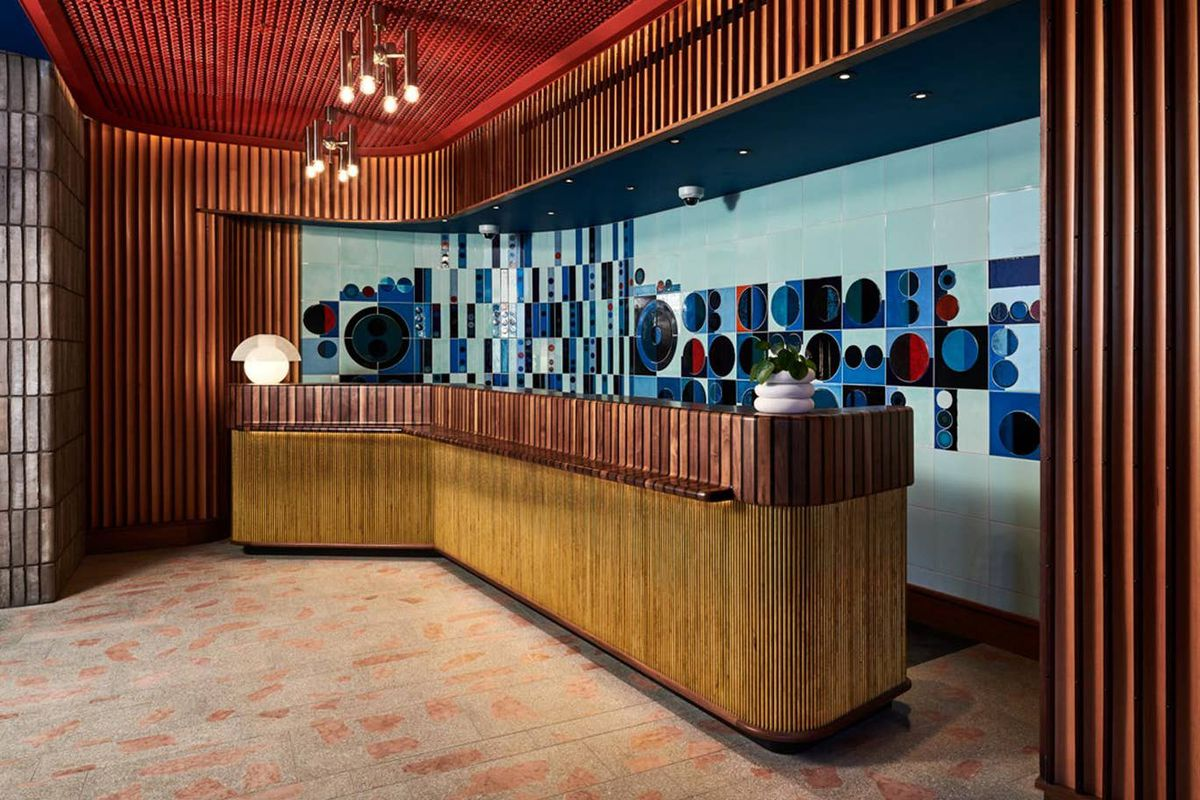 Front desk of hotel with colorful backdrop