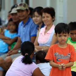 People wait in line for health care at an LDS chapel in Ormoc, Tuesday, Nov. 19, 2013.