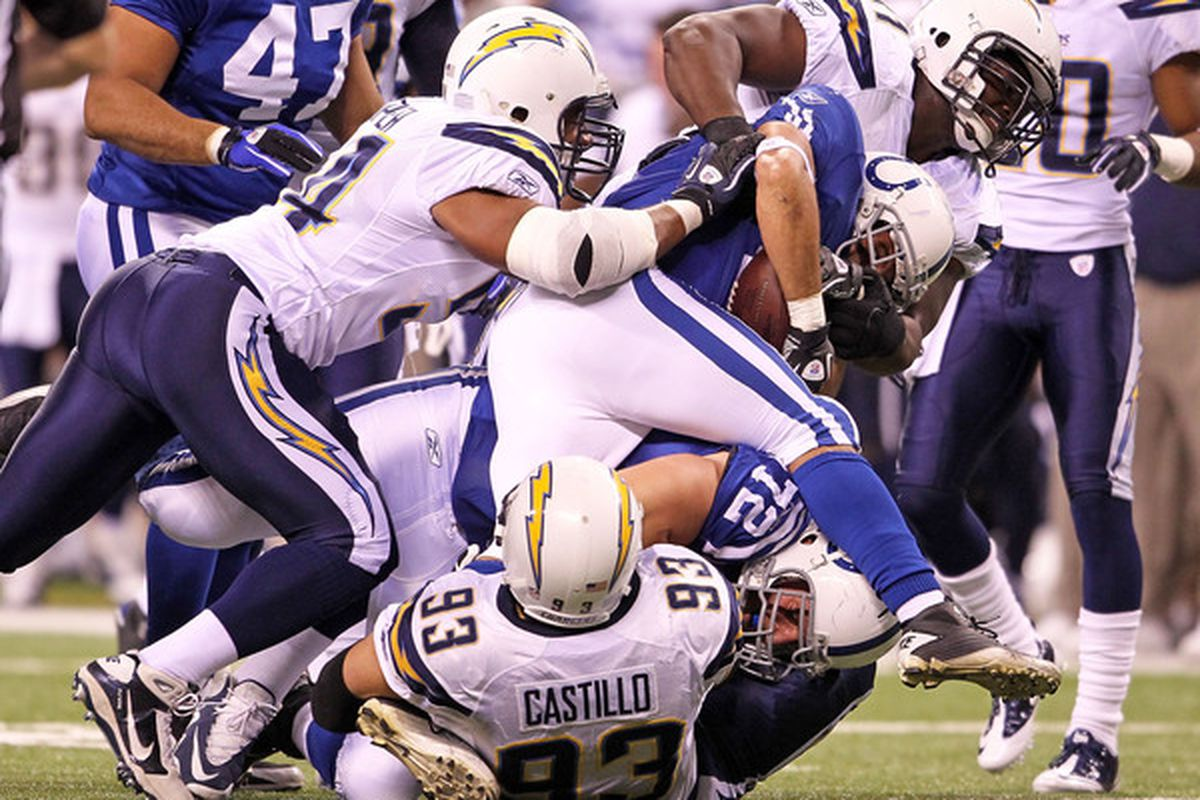 Donald Brown #31 of the Indianapolis Colts is tackled by Luis Castillo #93 of the San Diego Chargers.  (Photo by Andy Lyons/Getty Images)
