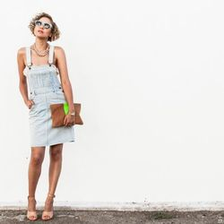 """Taye of <a href=""""http://www.stuffshelikes.net""""target=""""_blank"""">Stuff She Likes</a> is wearing an American Rag Vintage dress, a Clare Vivier clutch, 3.1 Phillp Lim shoes, a Zara top and Charlotte Ronson x Vogue Eyewear sunglasses."""