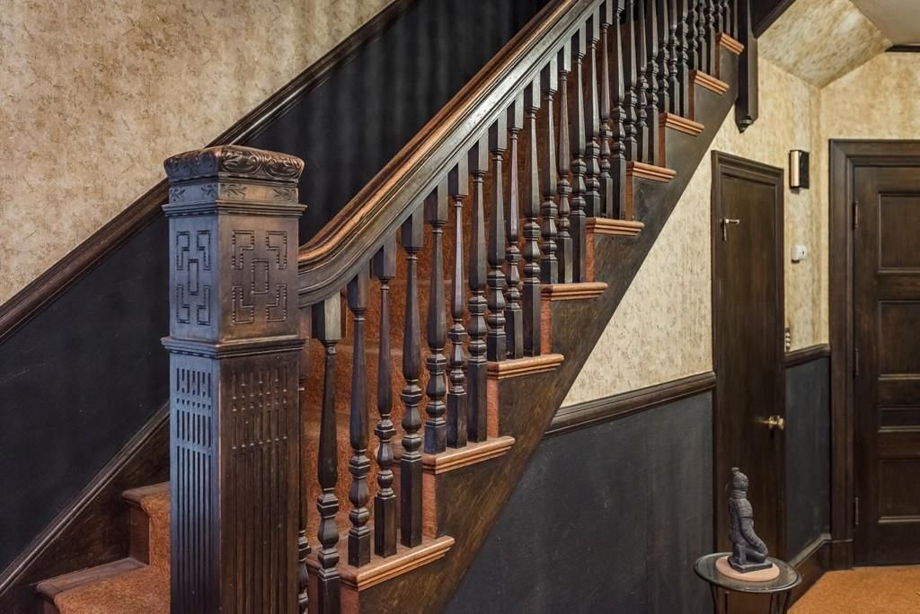 A carved-wood staircase up close.