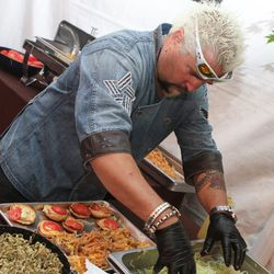 Guy Fieri working the burger station