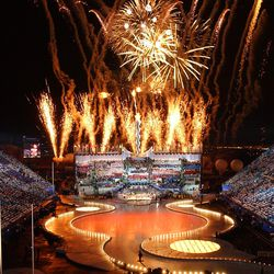 Fireworks explode during the 2002 Winter Games closing ceremony on Sunday, Feb 24, 2002, at the University of Utah's Rice-Eccles Stadium.