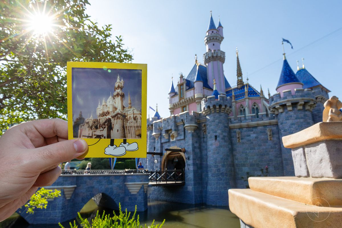 Polaroid photo of the Sleeping beauty castle held in front of the newly painted castle