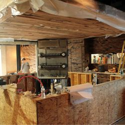 Large center bar to have concrete bar top and backing.