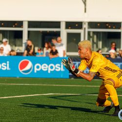 June 25, 2019 - Madison, Wisconsin, United States - Minnesota United goalkeeper Dayne St. Clair (97) makes a save during the Forward Madison FC vs Minnesota United FC friendly match at Breese Stevens Field.