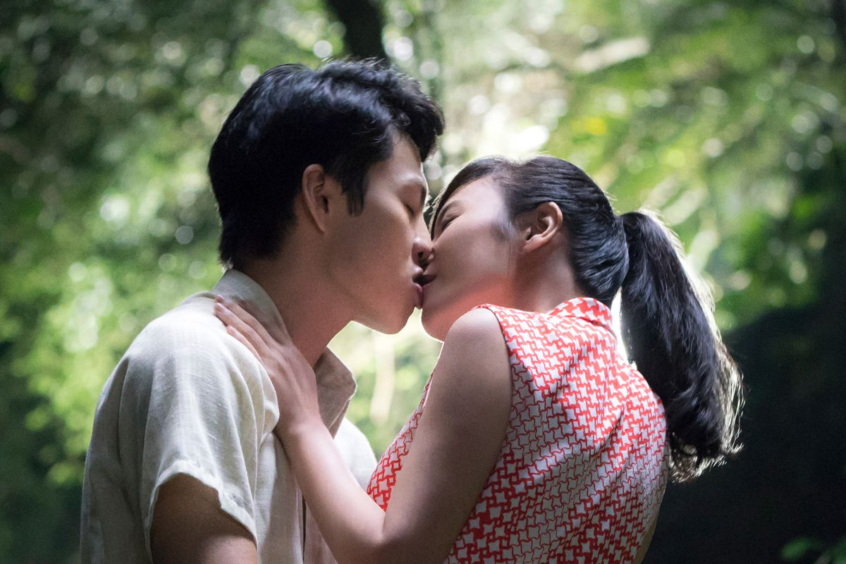 A man and a woman kiss.