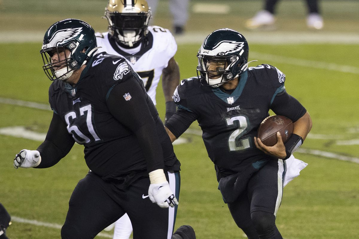 Jalen Hurts #2 of the Philadelphia Eagles runs with the ball as Nate Herbig #67 blocks against the New Orleans Saints at Lincoln Financial Field on December 13, 2020 in Philadelphia, Pennsylvania.
