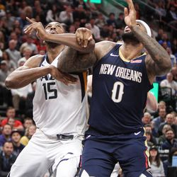 Utah Jazz forward Derrick Favors (15) and New Orleans Pelicans center DeMarcus Cousins (0) fight for position under the basket as Utah hosts New Orleans at Vivint Arena in Salt Lake on Friday, Dec. 1, 2017.