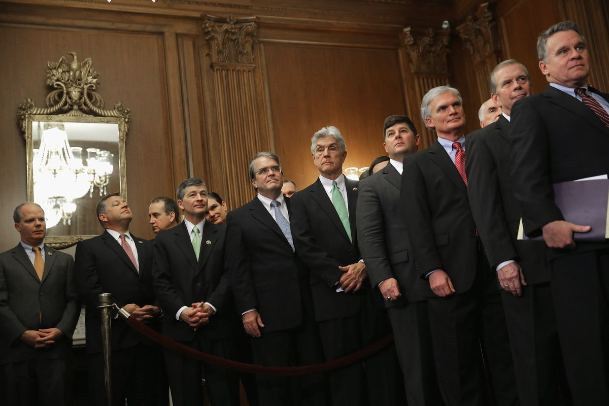 A phalanx of House Republicans celebrate passing a bill to repeal Obamacare and defund Planned Parenthood.