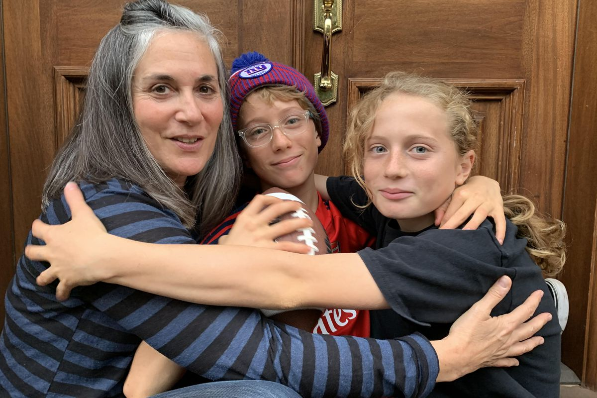 Mimi Turner's twin boys, Becket Tavenner (middle) and Dashiell Tavenner (right) were assigned to different middle schools this year.  Parents in District 15 pressed the education department to change its admissions policies to allow twins to stay together at the same middle school.