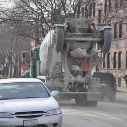 Concrete truck headed west on Waveland, leaving a trail of dust -