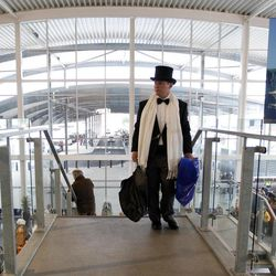 A passenger in evening dress  hurries as he goes to check in for the MS Balmoral Titanic memorial cruise in Southampton, England, Sunday, April  8, 2012. Nearly 100 years after the Titanic went down, a cruise with the same number of passengers aboard is setting sail to retrace the ship's voyage, including a visit to the location where it sank. The Titanic Memorial Cruise is set to depart Sunday from Southampton, where the Titanic left on its maiden voyage. The 12-night cruise will commemorate the 100th anniversary of the sinking of the White Star liner. With 1,309 passengers aboard, the MS Balmoral will follow the same route as the Titanic. Organizers are trying to recreate the onboard experience  minus the disaster  from the food to a band playing music from that era. Organizers said people from 28 countries have booked passage, including relatives of some of the more than 1,500 people who died when the Titanic collided with an iceberg and sank on April 15, 1912.