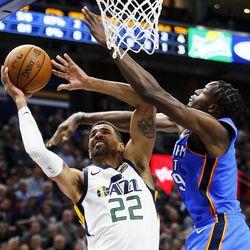 Utah Jazz forward Thabo Sefolosha takes a shot with Oklahoma City Thunder forward Jerami Grant defending during NBA basketball in Salt Lake City on Saturday, Dec. 23, 2017.