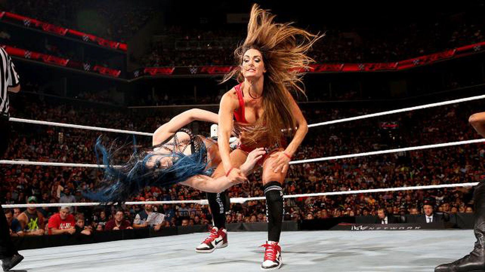 gif nikki bella destroys paige with a vicious forearm