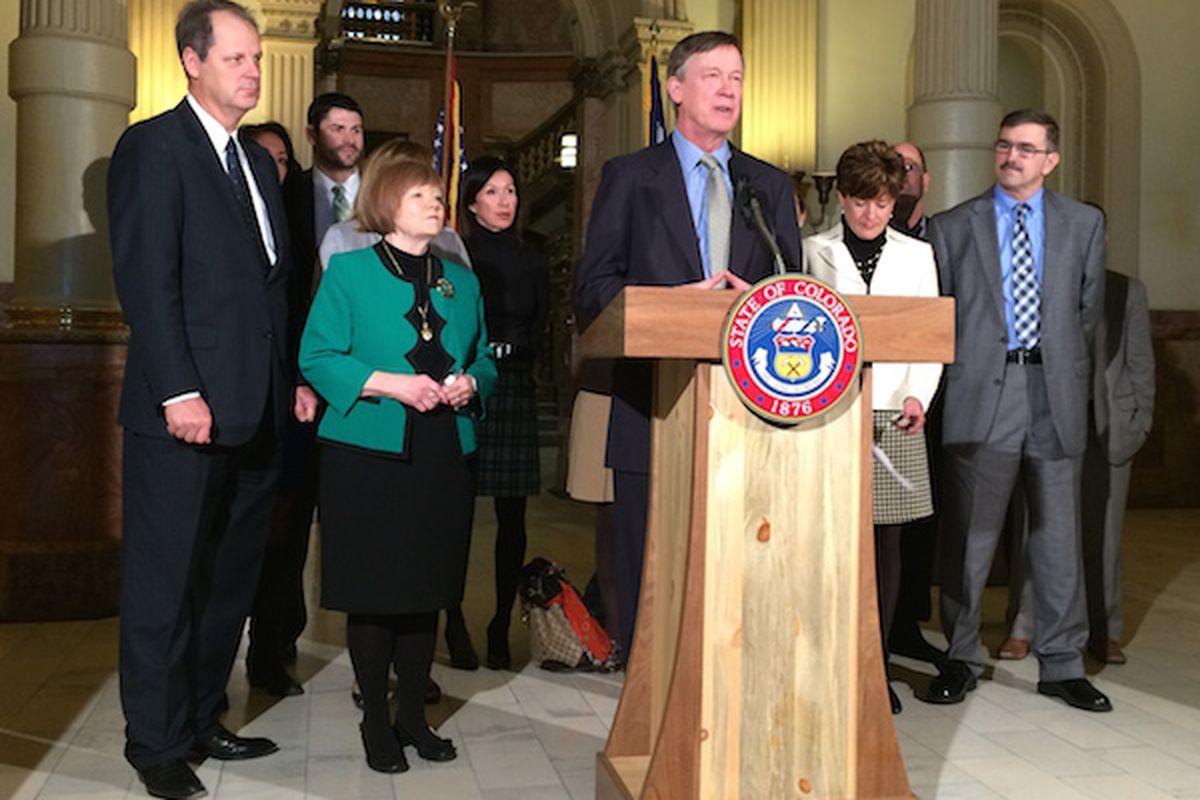 Gov. John Hickenlooper spoke on testing Tuesday, flanked by Senate President Bill Cadman (left) and House Speaker Dickey Lee Hullinghorst.