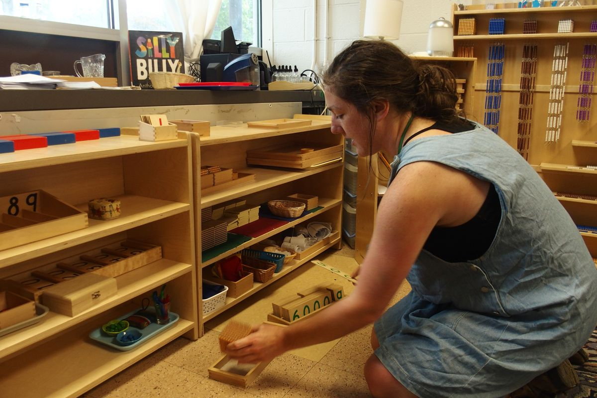 Tori Long, who teaches special education at Libertas, demonstrates how the Montessori method's emphasis on hands-on learning can make learning concepts like addition and division more accessible to students.