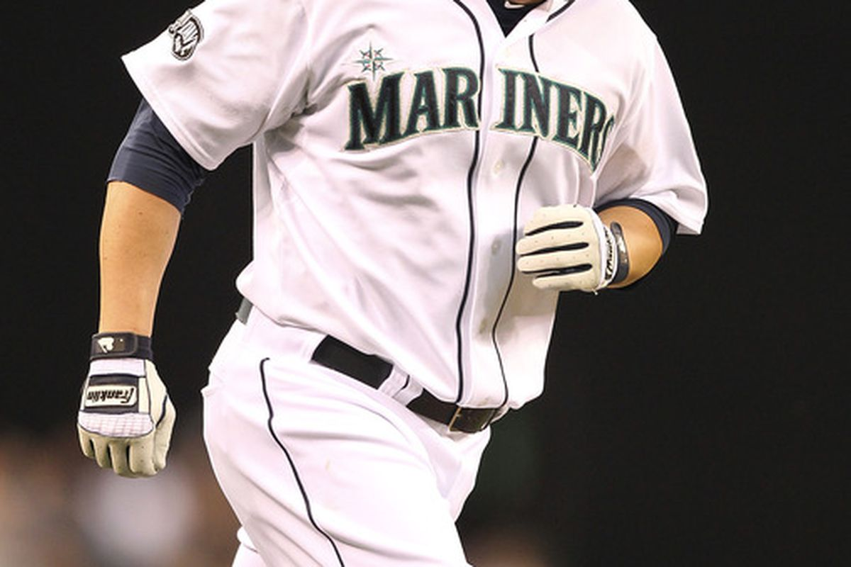 SEATTLE - JUNE 28:  Jack Cust #29 of the Seattle Mariners rounds the bases after hitting a solo home run against the Atlanta Braves at Safeco Field on June 28, 2011 in Seattle, Washington. (Photo by Otto Greule Jr/Getty Images)