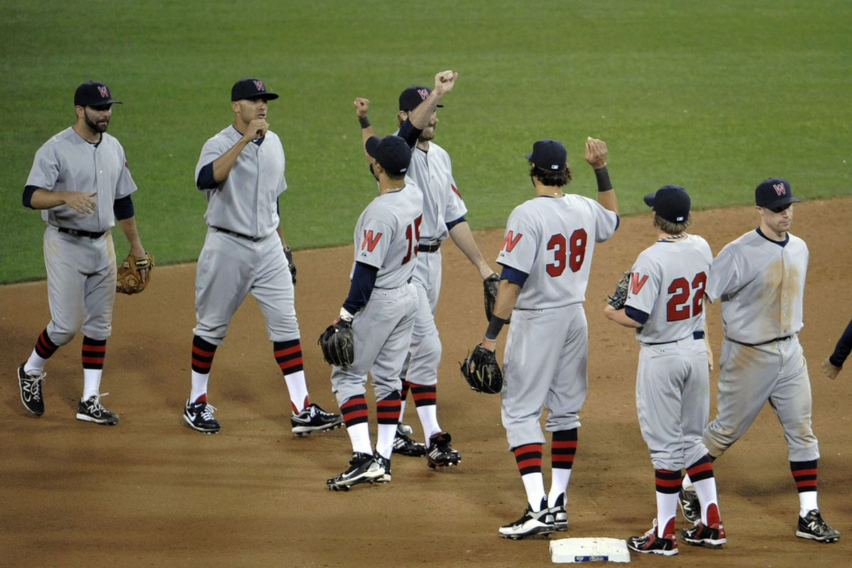 SAN DIEGO, CA - JUNE 11: Washington Nationals players high-five after the Nationals beat the San Diego Padres 2-1 at Petco Park on June 11, 2011 in San Diego, California.  (Photo by Denis Poroy/Getty Images)