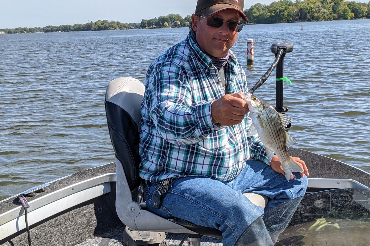 Guide Phil Piscitello with one of the dozens of fish caught last week on the Chain O'Lakes. Credit: Dale Bowman