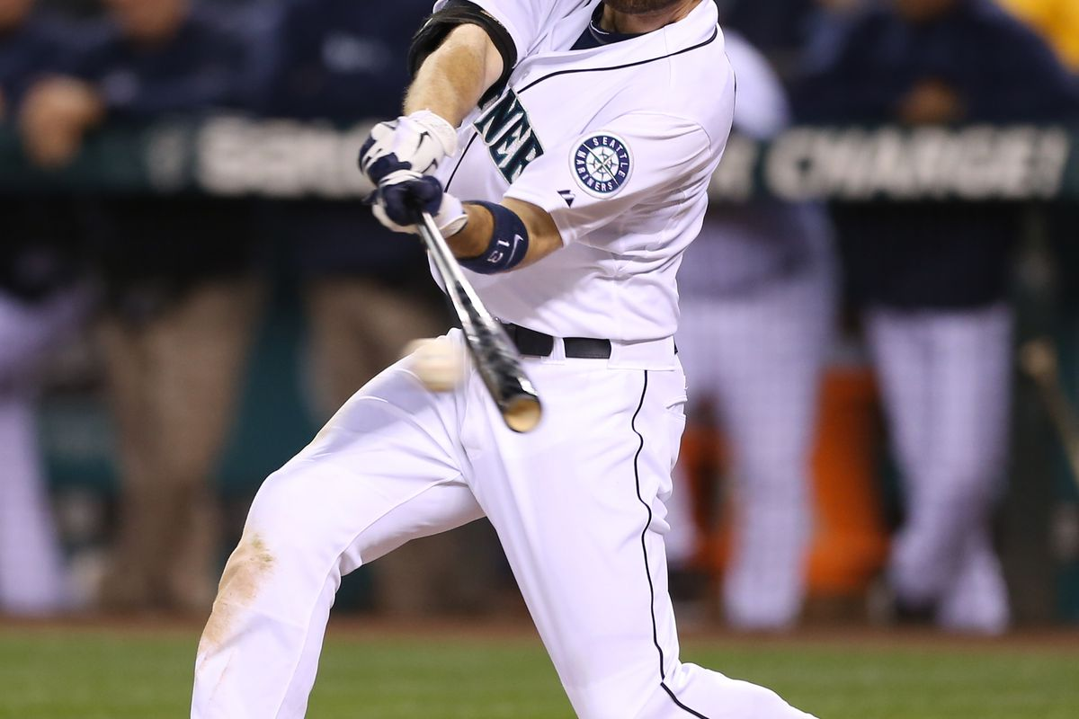 SEATTLE, WA - SEPTEMBER 05:  Dustin Ackley #13 of the Seattle Mariners hits a two-RBI single in the fourth inning against the Boston Red Sox at Safeco Field on September 5, 2012 in Seattle, Washington.  (Photo by Otto Greule Jr/Getty Images)