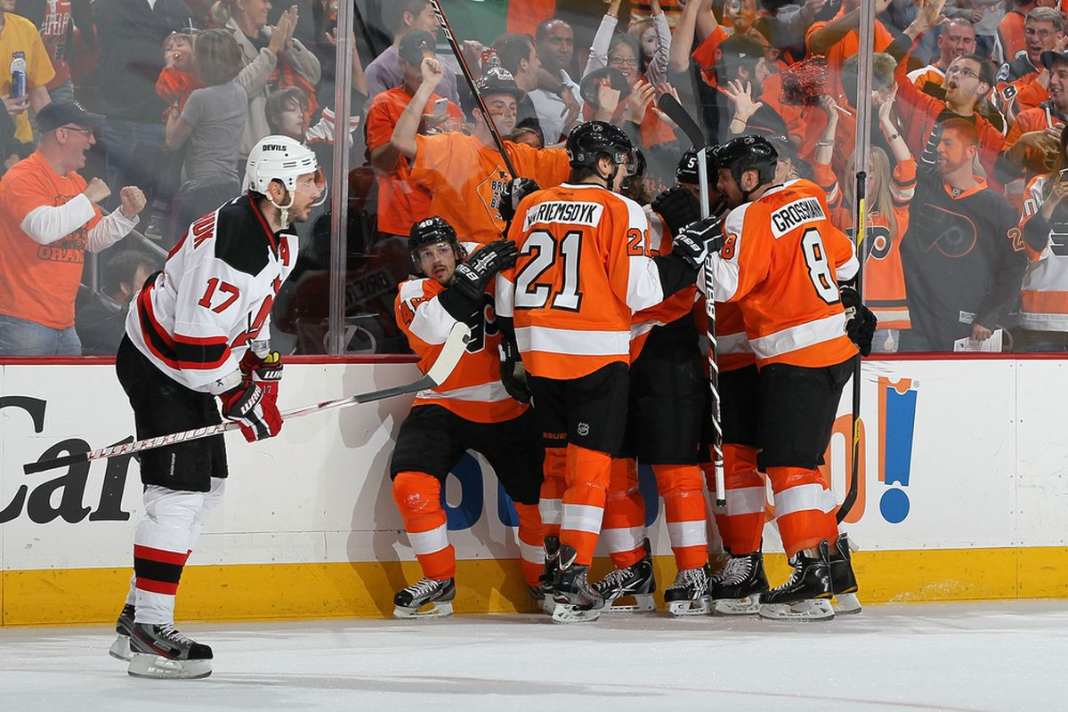 A lot of people noticed Kovalchuk hunched over; though this wasn't during the play - no, it was after a Flyers score. (Photo by Jim McIsaac/Getty Images)