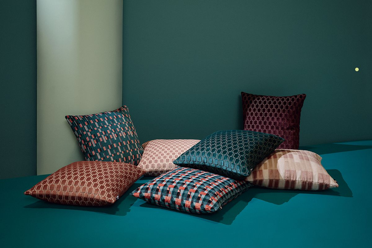 Pillows upholstered in patterned fabric.
