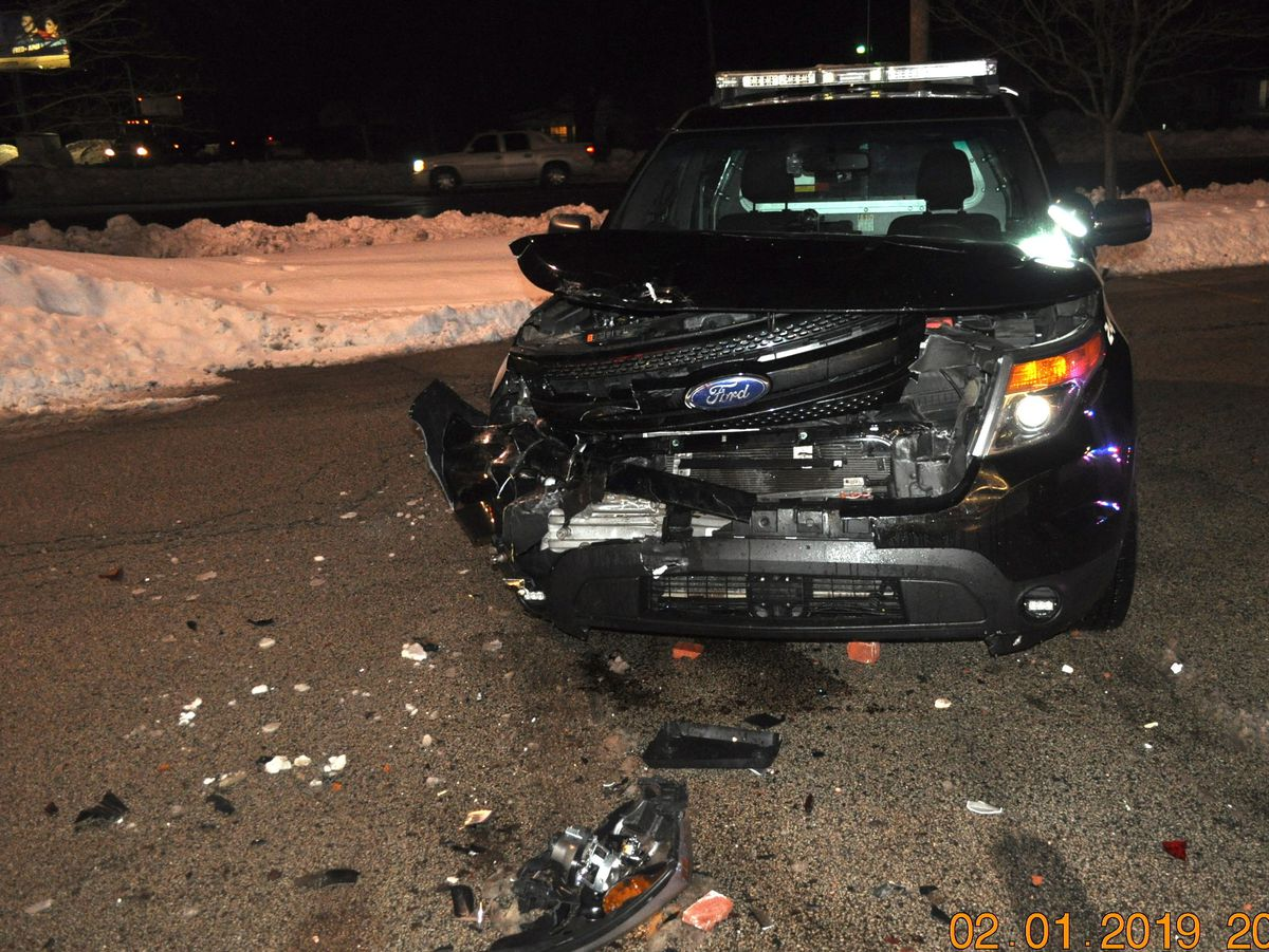 A Zion police car was damaged by a driver Friday evening in a CVS parking lot. | Zion police