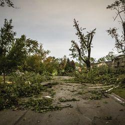 Tornado damage on Chestnut Ave. in Woodridge early Monday morning.