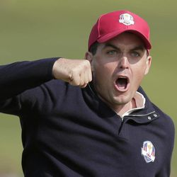 USA's Keegan Bradley celebrates after winning their foursomes match on the 15th hole at the Ryder Cup PGA golf tournament Friday, Sept. 28, 2012, at the Medinah Country Club in Medinah, Ill.