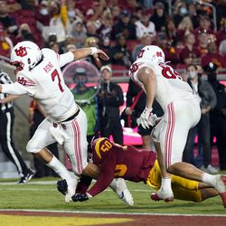 Utah quarterback Cameron Rising (7) scores a rushing touchdown past Southern California defensive lineman Nick Figueroa (50) during the second half of an NCAA college football game Saturday, Oct. 9, 2021, in Los Angeles.